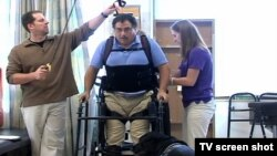 A paralyzed man wears a bionic skeleton to help him walk again.