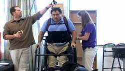 Robotic Suit Helps Paralyzed Man Walk