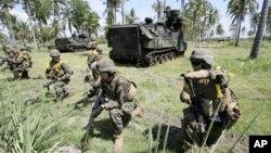 AQSh askarlari Indoneziya bilan qo'shma harbiy mashqlar chog'ida. 5-iyun 2012.
