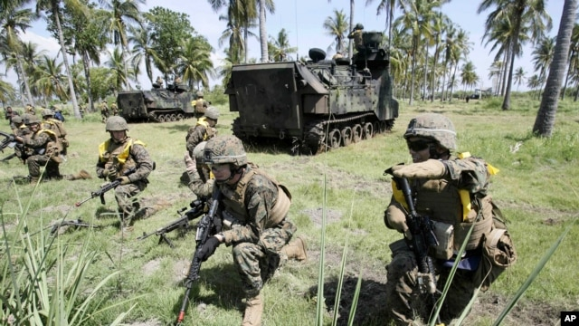 U.S. Marines take their position during a joint amphibious assault exercise with their Indonesian counterparts on Banongan beach in Situbondo, East Java, Indonesia, June 5, 2012.