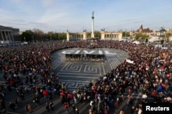 People protest in Heroes' Square against a new law that would undermine Central European University, a liberal graduate school of social sciences founded by U.S. financier George Soros in Budapest, Hungary, April 12, 2017.
