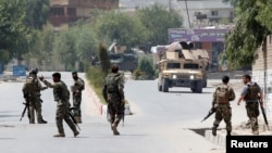 Afghan National Army (ANA) soldiers arrive at the site of gunfire and attack in Jalalabad city, Afghanistan, July 11, 2018.