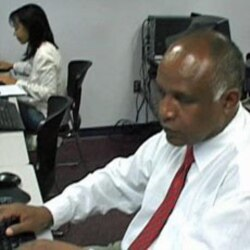 Yafet Deferesu from Ethiopia and Perline Rasoanoromalala from Madagascar working on their resumes