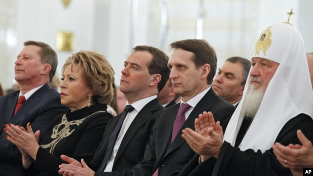 Russian dignitarites applaud before President Vladimir Putin's state-of-the nation address in the Kremlin in Moscow, Dec. 12, 2012.