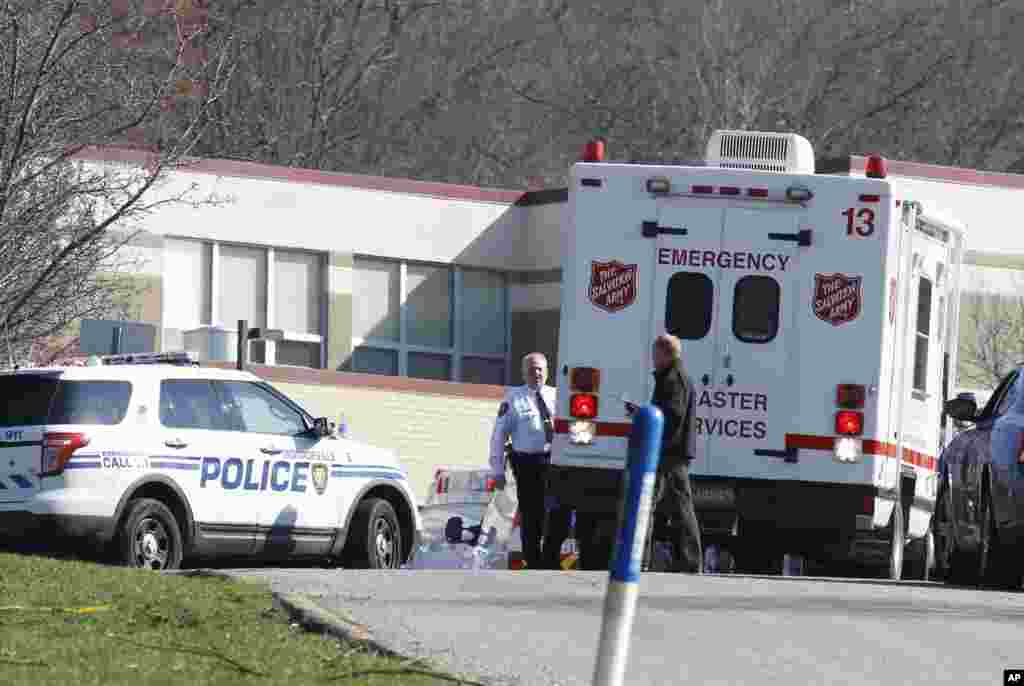 Emergency responders gather on the campus of the Franklin Regional School District where several people were stabbed at Franklin Regional High School, Myrrysville, Pennsylvania, April 9, 2014.