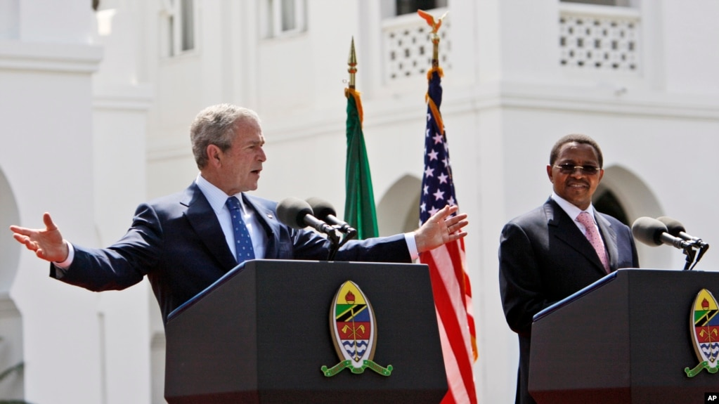 FILE – President George W. Bush speaks at a news conference with then-Tanzanian President Jakaya Mrisho Kikwete in Dar es Salaam, while on a five-nation visit to Africa, Feb. 17, 2008. The law that transformed the battle against HIV/AIDS in developing countri