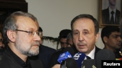Syrian Parliament speaker Mohammed Jihad al-Laham (R) and his Iranian counterpart Ali Larijani speak to the media in Damascus, Syria, November 23, 2012.