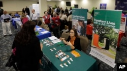 U.S. veterans attend the annual Veterans Career and Resource Fair in Miami, Feb. 6, 2015.