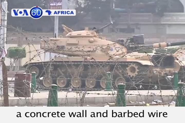 Army puts up a concrete wall around the presidential palace in Cairo after deadly clashes.