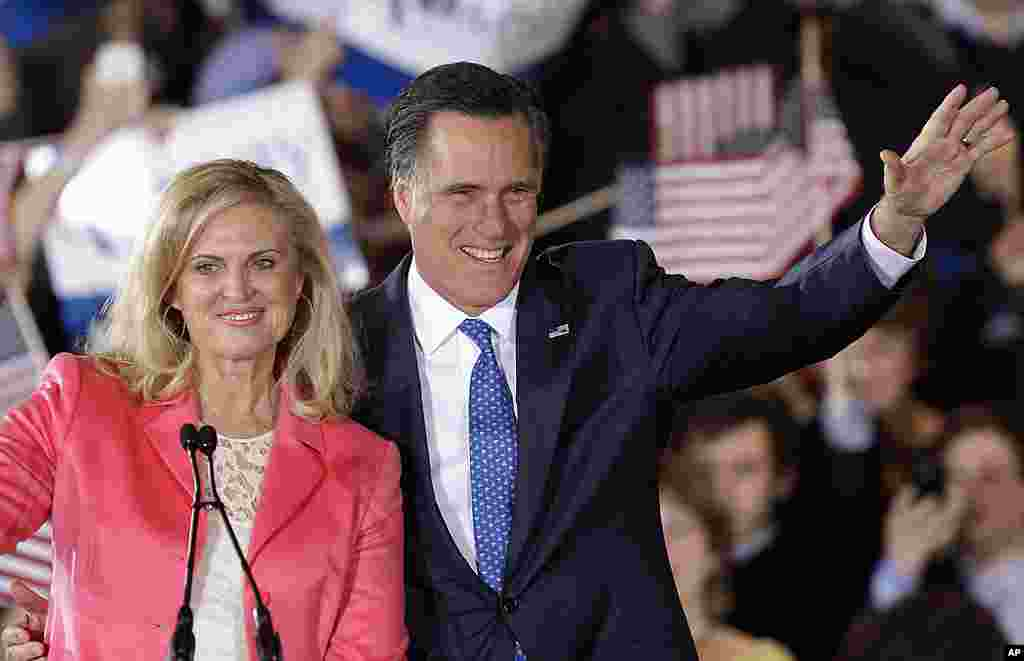 Republican presidential candidate Mitt Romney and his wife Ann wave to supporters at his Super Tuesday campaign rally in Boston, Massachusetts, March 6, 2012. (AP)