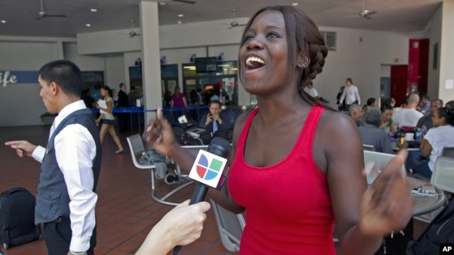 Niouseline St. Jean, originally from Turks and Caicos Islands, who lives in the U.S. illegally, talks about the new immigration ruling for students at Miami Dade Community College in Miami, June 15, 2012.