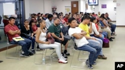 Mexican nationals wait to be seen at the Mexican consulate, March 3, 2017, in Miami.