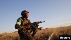 Militar moçambicano em exercícios da Uniāo Africana, no campo de treino Lohatla, África do Sul.2015