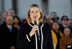 FILE - Britain's Home Secretary Amber Rudd speaks during a vigil in Trafalgar Square, London, March 23, 2017.