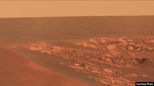 "A view of the surface of Mars taken at the ""Intrepid"" crater by the Opportunity Mars Rover on November 11, 2010. Humans could see this landscape with their own eyes by the 2030s. (NASA)"