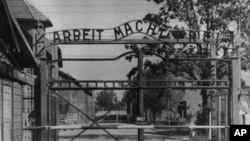 "FILE - This undated file image shows the main gate of the Nazi concentration camp Auschwitz I, which was liberated by the Soviets in January 1945. Writing over the gate reads: ""Arbeit macht frei"" (Work makes you free)."