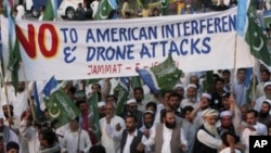 Supporters of a Pakistani religious party Jamaat-e- Islami arrive to join a rally against the U.S. drone strikes in Pakistani tribal areas, in Peshawar, April 23, 2011