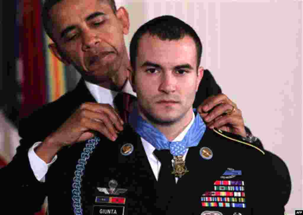 Nov. 16: President Obama presents the Medal of Honor to Staff Sgt. Salvatore Giunta, who rescued two members of his squad in October 2007 while fighting in the war in Afghanistan. (AP Photo/J. Scott Applewhite)