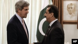 U.S. Senator John Kerry and Pakistan Prime Minister Yusuf Raza Gilani prior to official talks in Islamabad shortly after U.S. special forces killed Osama bin Laden in Abbottabad in May 2011 (file photo).
