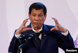 FILE - Philippines' President Rodrigo Duterte gestures during a news conference on the sidelines of the Association of South East Asian Nations summit in Pasay, metro Manila, Philippines, Nov. 14, 2017.