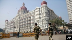 Indian police officers walk outside the Taj Mahal Hotel, one of the sites of the Mumbai terror attacks on its ninth anniversary in Mumbai, India, Nov. 26, 2017. The attack by Pakistani gunmen in India's financial capital on Nov. 26, 2008 killed 166 people.