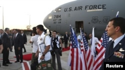 U.S. Secretary of Defense Leon Panetta (2nd L) is welcomed after arriving in Tel Aviv, Israel July 31, 2012.