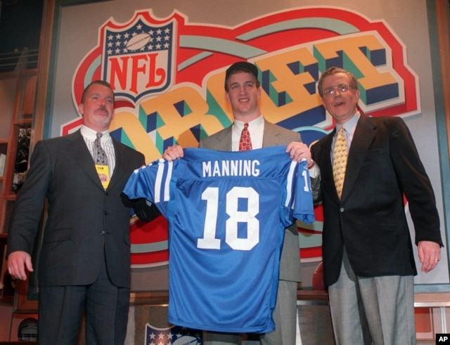 FILE - In this April 18, 1998, file photo, Peyton Manning holds up an Indianapolis Colts jersey as he is flanked by Colts owner Jim Irsay, left, and NFL Commissioner Paul Tagliabue after being chosen as the No.