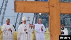 Pope Francis celebrates his final Mass of his week-long visit to Brazil, on Copacabana Beach in Rio de Janeiro, July 28, 2013.
