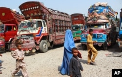 FILE - Afghan refugees living in Pakistan arrive at the UNHCR's Repatriation Center en route to Afghanistan, in Peshawar, Pakistan, Sept. 9, 2016.