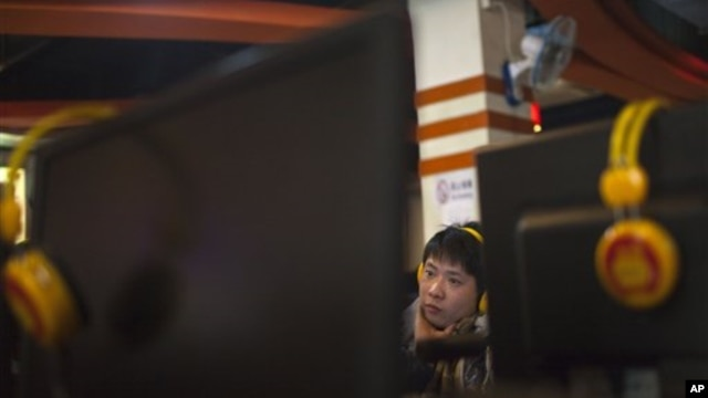 A man uses a computer at an Internet cafe in Beijing, Friday, Dec. 28, 2012. China is increasing already tight controls on Internet use and electronic publishing after embarrassing online reports about official abuses.