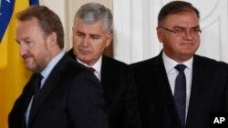 FILE - Members of Bosnia's tripartite presidency, Muslim Bosniak member, Bakir Izetbegovic (L), Croat member Dragan Covic (C) and Serb member, Mladen Ivanic, are seen at the presidency's inauguration ceremony in Sarajevo, Bosnia, Nov. 17, 2014.
