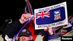FILE - Falkland islanders react after hearing the results of the referendum in Stanley, March 11, 2013. Residents of the Falkland Islands voted almost unanimously to stay under British rule in a referendum that has inflamed a long-running sovereignty dispute with Argentina.