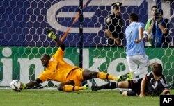 "FILE -- D.C. United goalkeeper Bilal ""Bill"" Hamid, left, stops a shot on the goal."