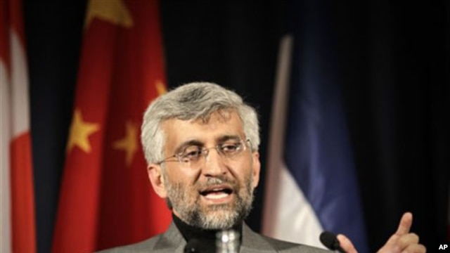 Iran's chief negotiator Saeed Jalili gestures during a press conference in Geneva, Switzerland, 07 Dec 2010