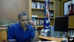 President Barack Obama holds a conference call from Camp David, Maryland, in this August 6, 2011 photo release. The deadliest day for U.S. forces in Afghanistan took place that day, when a Chinook helicopter crashed in Wardak, Afghanistan, killing 30 U.S