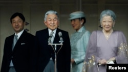 Left to right, Japan's Crown Prince Naruhito, Emperor Akihito, Crown Princess Masako and Empress Michiko acknowledge well-wishers who gathered to celebrate the monarch's 80th birthday at the Imperial Palace in Tokyo, Japan, Dec. 23, 2013.