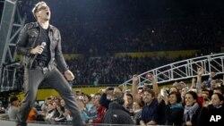 Lead singer Bono of Irish rock band U2 performs during their 360 Degree Tour (file photo)