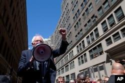 Democratic presidential candidate Sen. Bernie Sanders, I-Vt. speaks to Communication Workers of America (CWA) picketers in midtown Manhattan, New York, April 18, 2016.