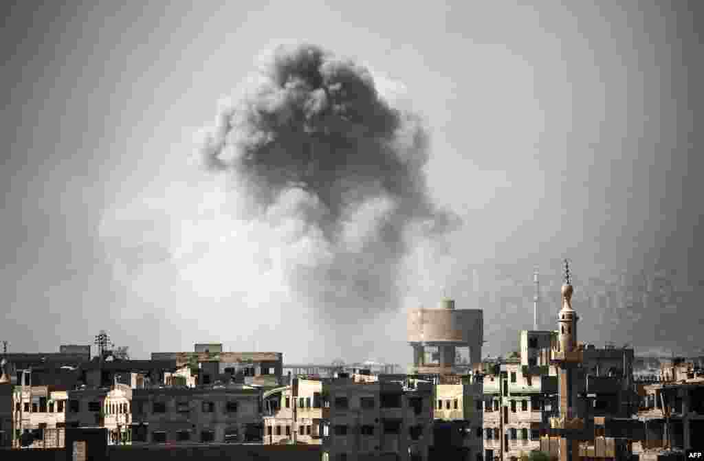 Smoke billows from buildings following a reported airstrike on Ain Tarma in the Eastern Ghouta area, a rebel stronghold east of the Syrian capital.