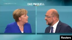 A screen that shows the TV debate between German Chancellor Angela Merkel of the Christian Democratic Union (CDU) and her challenger Germany's Social Democratic Party SPD candidate for chancellor Martin Schulz in Berlin, Germany, Sept. 3, 2017.