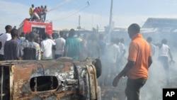 Un de récents attentats à la bombe à Maiduguri, Nigeria, 26 Novembre 2014.