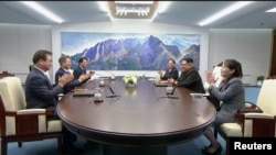 South Korean President Moon Jae-in and North Korean leader Kim Jong Un attend the inter-Korean summit at the truce village of Panmunjom, in this still frame taken from video, South Korea, April 27, 2018.