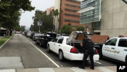 Police work at the scene of a shooting at the University of California, Los Angeles, June 1, 2016.