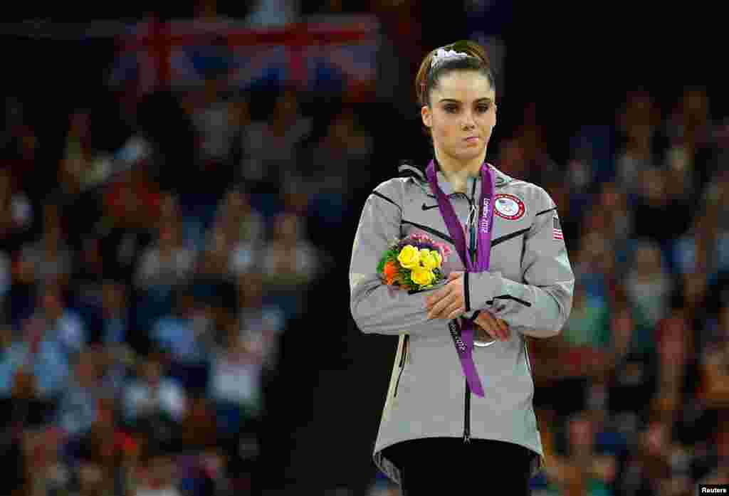 August 5: McKayla Maroney of the U.S. with her silver medal in the women's vault victory ceremony during the London 2012 Olympic Games.