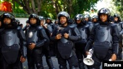 Indonesian policemen are deployed outside the Burmese embassy during a protest by Indonesian Muslim hardline groups in Jakarta, May 3, 2013.