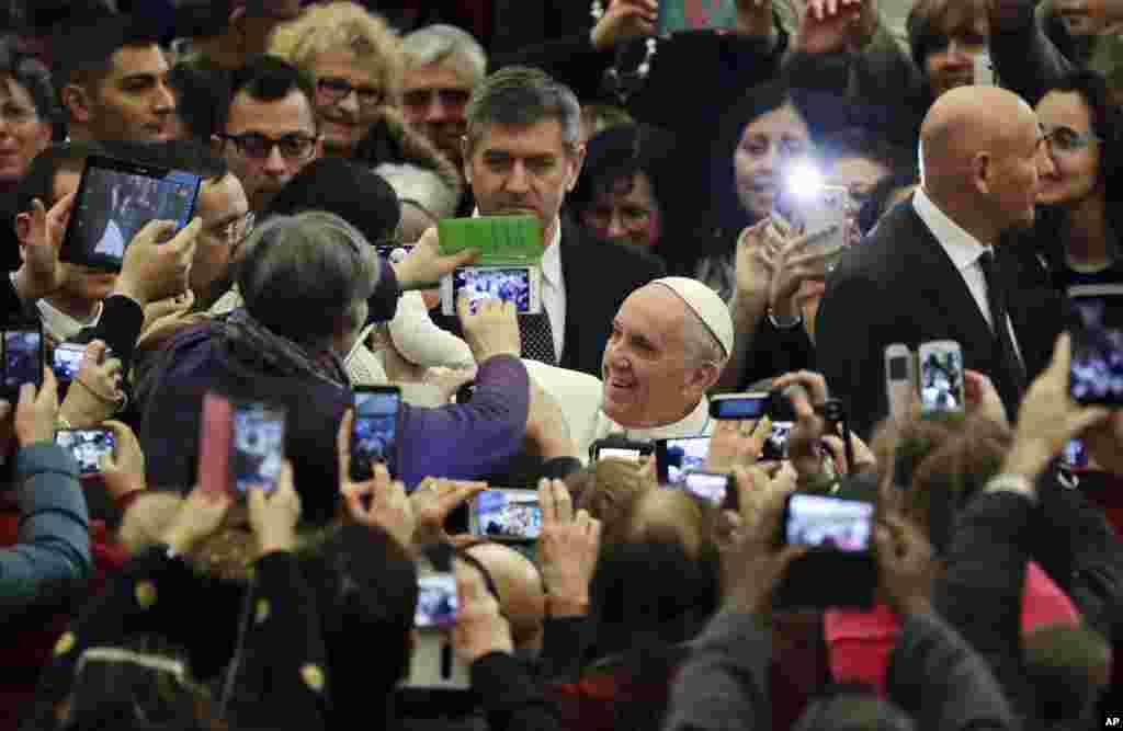 Pope Francis arrives for an audience with residents of the areas of central Italy hit by earthquakes, in the Pope Paul IV hall, at the Vatican.