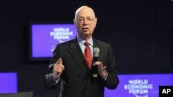 """WEF founder, Klaus Schwab opens a session of the """"Social Forum"""" at the World Economic Forum in Davos, Switzerland, 25 Jan 2011"""