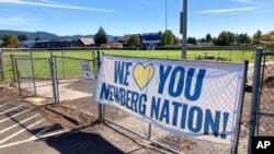 A banner thanking supporters of Newberg schools is seen Sept. 21, 2021, next to the athletic fields of Newberg High School, in Newberg, Ore.