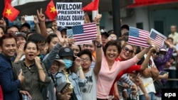 Vietnamese wait for US President Barack Obama outside the Jade Pagoda in Ho Chi Minh City, Vietnam, May 24, 2016.
