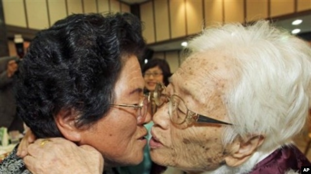 FILE - South Korean mother Kim Rye-jung, 96, right, kisses her North Korean daughter Woo Jung Hye during the Separated Family Reunion Meeting at Diamond Mountain in North Korea.